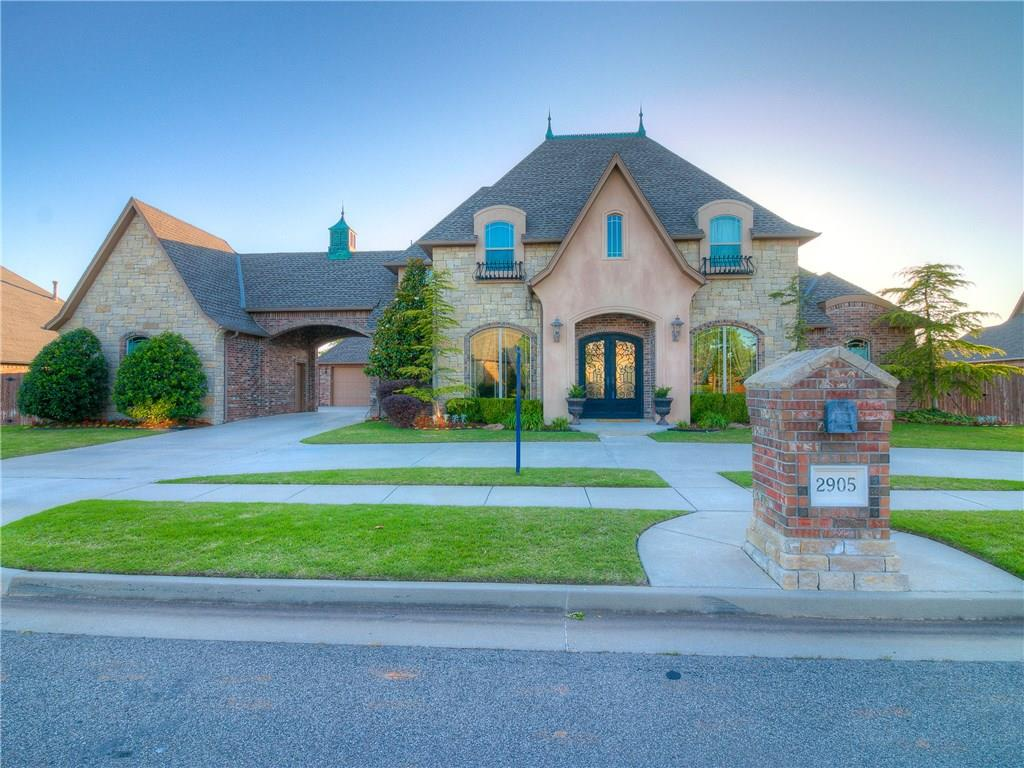 Absolutely stunning French Country home located in the gated community, the Willows! Offering over 4000 SF to include 4 spacious bedrooms (2 up/2 down) each with their own bath, study with built ins, formal dining room, butler's pantry, upstairs media room, wet bar with fridge/ice maker/microwave/sink, upstairs study nook with built in desk, and a balcony overlooking the nearly 1/2 acre lot! The huge back yard backs to open land so there are no neighbors behind and the porte-cochere provides plenty of driveway space. Above ground safe room in the garage adds extra safety and peace of mind and the extra washer/dryer hook ups in the master and the central vacuum system offer efficiency for your every day tasks. A sweeping iron stair case welcomes you into the home; wood floors throughout the main areas add warmth, and the chef's kitchen is outfitted with a huge island with prep sink and a commercial range/oven.