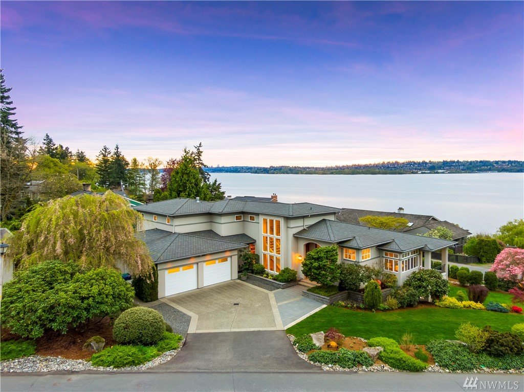 Spectacular views of lake, mountains & DT Seattle from this sprawling home on meticulously landscaped DOUBLE LOT in coveted West of Market. Well appointed kitchen, great room & dining room interact seamlessly with expansive outdoor living. Office & gym on main, bonus & guest suite w/ bath on lower. 900 Sqft master suite w/ 5 piece bath & VIEWS on upper. Full landscape irrigation & lighting. Wired generator & AC! 700 sqft heated & detached space has .5 bath & ADU potential! Make it yours!