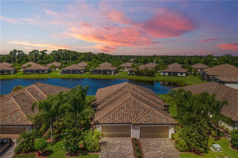 "Florida SUNSETS await you at this Fantastic OPEN floor plan Villa with WATER views! Enjoying the CONVENIENCE of being minutes away from resort style amenities in River Strand Golf & Country Club is what this UNIQUE, Social Membership Villa offers.  UPGRADES: extended lanai, custom lighting throughout, custom CLOSETS in master & Guest Bedroom, pull-outs in the Kitchen cabinets, Garage storage Cabinets, gutters added, newer water heater, Hunter Douglas Plantation Shutters/Window Treatments & a whole-home surge protector. Play some Pickleball or enjoy 1 of the 8 pools then relax on your private lanai. The kitchen boasts granite counter tops, wood cabinetry, stainless appliances along with custom lighting with dimmers. This Villa is Move-In Ready! River Strand Golf & Country Club is a warm and friendly community with a 27-hole Arthur Hills designed golf course, 9 Har-Tru Tennis Courts, 8 Pickleball courts, 2 Resort-Style Pools, 6 Satellite Pools, Clubhouse with restaurant, social events, Community Center & 2 fitness centers in this luxury gated community with 24 hr. security & lawn maintenance .  Convenient location to I-75, University Town Center, & beaches complete the package.  River Strand Golf & Country Club More than a Community, It's a Lifestyle.<br /><br /> <a href=""https://www.youtube.com/watch?v=HkE8Nr6ofEs&feature=youtu.be"" onclick=""window.open('https://www.youtube.com/watch?v=HkE8Nr6ofEs&feature=youtu.be',                           'newwindow',                           'width=700,height=500');                return false;""  >RIVER STRAND HOME SEARCH VIDEO TOUR</a>"