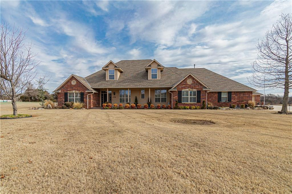Wow! This STUNNING HOME is located in a very peaceful neighborhood in the coveted Wheatland Estates,  at the end of the cul-de-sac, on a lovely 1.35 acres with grazing horses as your view from your back porch. Even with the unbelievable setting, this home is extremely convenient to shopping in S. OKC, Mustang,& take the Turnpike easily to NW OKC! This well cared for one-owner, custom-built home, boasts 3 large bedrooms, each with their own full bath en-suites. A warm study with beautiful hard-wood floors and built-in cabinets and shelves. The open floorplan invites a beautiful yet functional formal dining, living and kitchen area with high-end stainless steel appliances, great for entertaining. This home has a theater room upstairs with actual vintage theater seats, a projection screen with surround sound and mini-kitchen. Perfect for friends and family. A 3 car attached & 2 car detached garage, large covered front and back porches, central vacuum, plantation shutters and so much more!