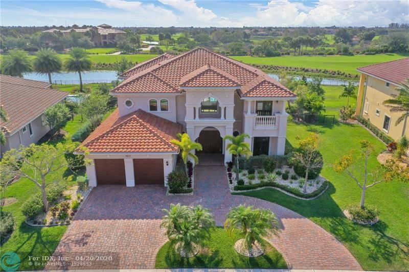 This upgraded two-story home, built to entertain friends and family, is your dream home. Live the luxury resort lifestyle. The entrance sets the tone with a majestic staircase and a marble floor illuminated by an abundance of natural sunlight, directing your eyes to a vast scenic on the water golf view. 7 beds, 5 baths, built-in office, gourmet kitchen:6-burner gas range+tepaniaki, 2 dishwashers, 2 ovens, Instant Hot water. Open spaces with exceptional high ceilings, impact windows, electric blinds & sounds system. Relax on the magnificent patio area with custom pool, spa, beach area, led lights and jets while watching an unparalleled sunset view. This gated community features a 43,000 sq ft. clubhouse with 10 tennis, 4 pools , fitness, 2 dining facilities & much more! Check virtual tour