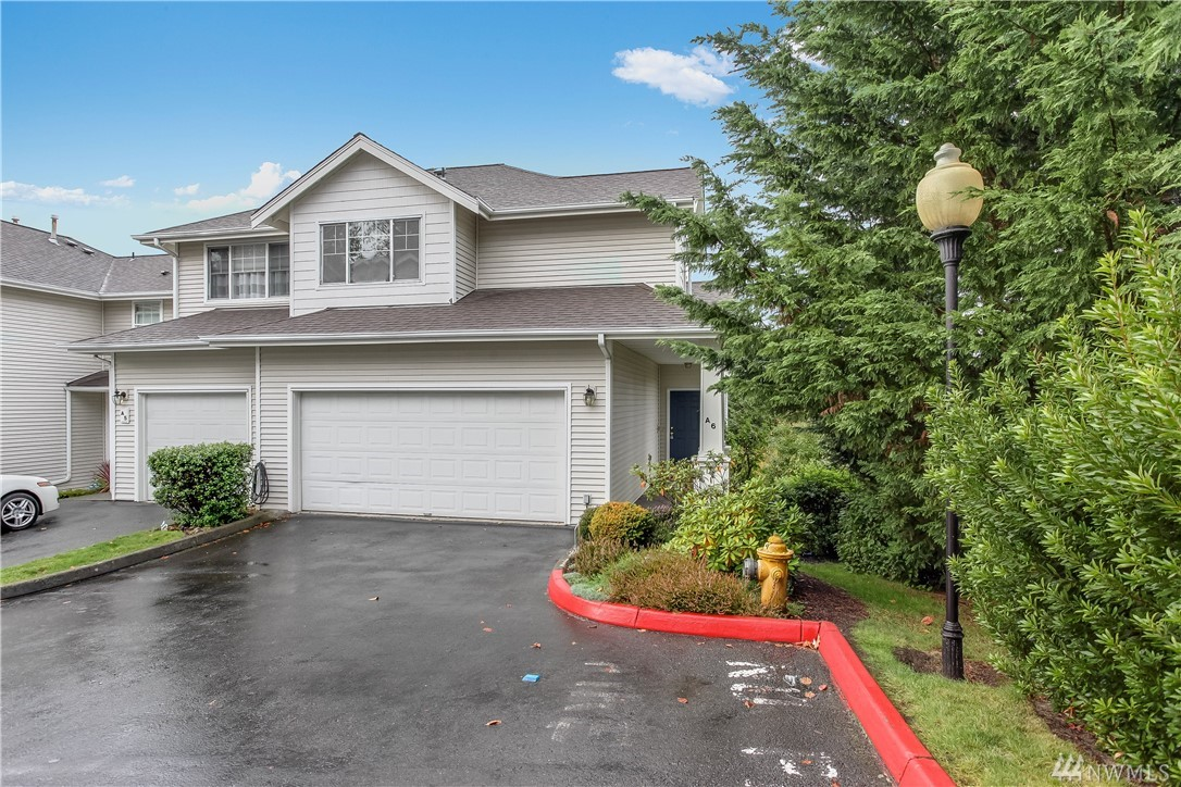 Welcome home to Westgate! RARE 4 bed/4 ba END unit w/privacy galore! Soaring ceilings, walls of windows & 3 levels of spacious living areas. Enjoy west facing valley & sunset views from kitchen & deck. Upstairs find 2 guest rooms & large master suite w/exquisite sunset views, walk-in closet & ensuite master bath. Lower level boasts huge family rm, 4th guest rm, 3/4 bath & slider to lawn. 2 car garage w/room for 2 additl cars. Commuter's dream w freeway access, airport, hospital & business hubs.