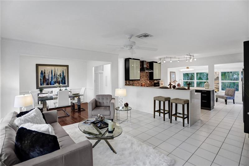 Offering freshly painted interior & exterior 3/2 Pool Home located in Central Wilton Manors. This gem of a home located on an amazing street blocks away from Wilton Drive. Beautiful landscaped  backyard and pool setting. Newer chefs Kitchen with a European flare. Owners suite  has a Cedar  lined closet. Along with a comfortable office area that over looks the lush pool. Newer roof & Freshly stained/painted driveway and carport.