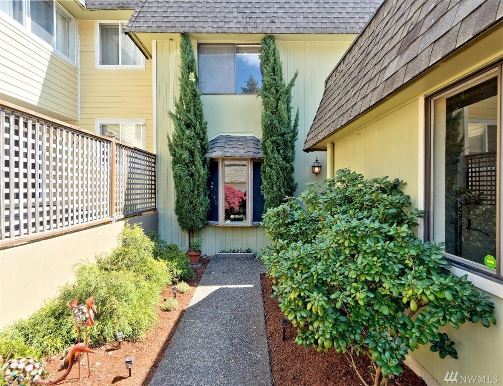 Here's your chance to own a 4 BR home in a resort style community complete w/comm.pool, clubhouse,free RV parking, tennis courts,tot play & BBQ area. Main level has been updated & upper level will need updating to make it your style (note the $20,000 price reduction to help). 2 BR's lead to deck, main level has spacious covered back deck leading to open green space that you don't need to mow!2 car gar.Master has a 3/4 bath,full bath up & 1/2 main.(Painters will be working upstairs this weekend).