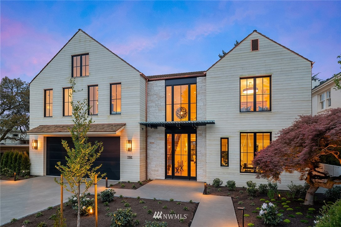 Exquisite, new construction home with views of the golf course and beyond. Just completed, the home features white oak floors, a great room with ship lap walls, wood beams and a stone fireplace with a reclaimed oak mantle. With loads of light, a wall of windows opens for a great flow to the yard and patio. In the two story entry, the grand staircase with custom blackened steel railing leads to the upper floor with spacious master suite, bonus room, study area and 3 additional bedrooms with en-suite baths. Other features include a gym, finished attic, and a covered, heated outdoor area with TV, grill and fireplace. Accoya siding will naturally age to a stunning driftwood grey.