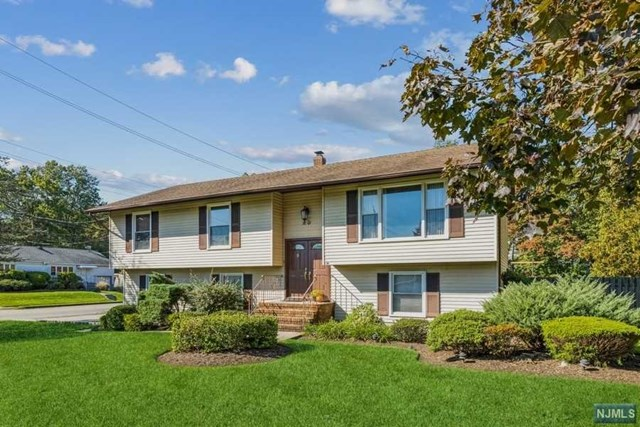 Corner property home front is on Moss Road . Some features of the home include an updated Kitchen with SS appliances, updated Baths, Master Bedroom with a full bath, Family Room SGD to the, Paver Patio , Hardwood floors and a first floor Office. Please note that half of one of the garages is used for the office.  Can easily be changed back to a 2 car. Don't miss this Move-in ready home so close to everything.  NYC transportation right outside your door.