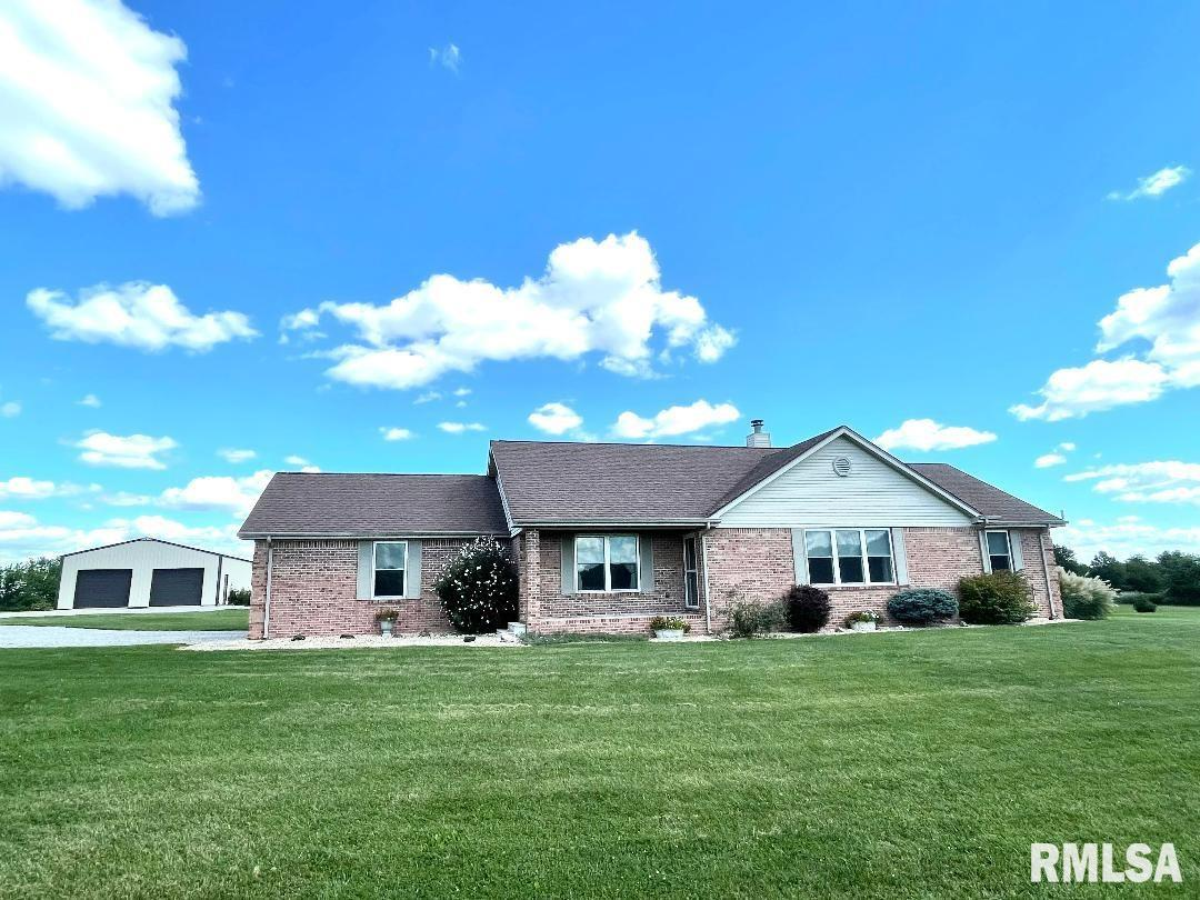 Don't miss out on this rare gem! 16.6 acres with a stocked pond is the setting for this beautiful all brick ranch home. This large 3 bedroom/2 bath home has a living room with fireplace, spacious master suite, large utility room and 2 car attached garage. Many recent updates including Pella windows and sliding door (within the last month) 48x30 outbuilding is insulated with concrete floor. Home has back up generator, beautiful landscaping and cathedral ceilings and tray ceilings.  Sit on the back deck and enjoy the wildlife wandering across this property.  There is also another building site near the pond.  Call today to see this one!