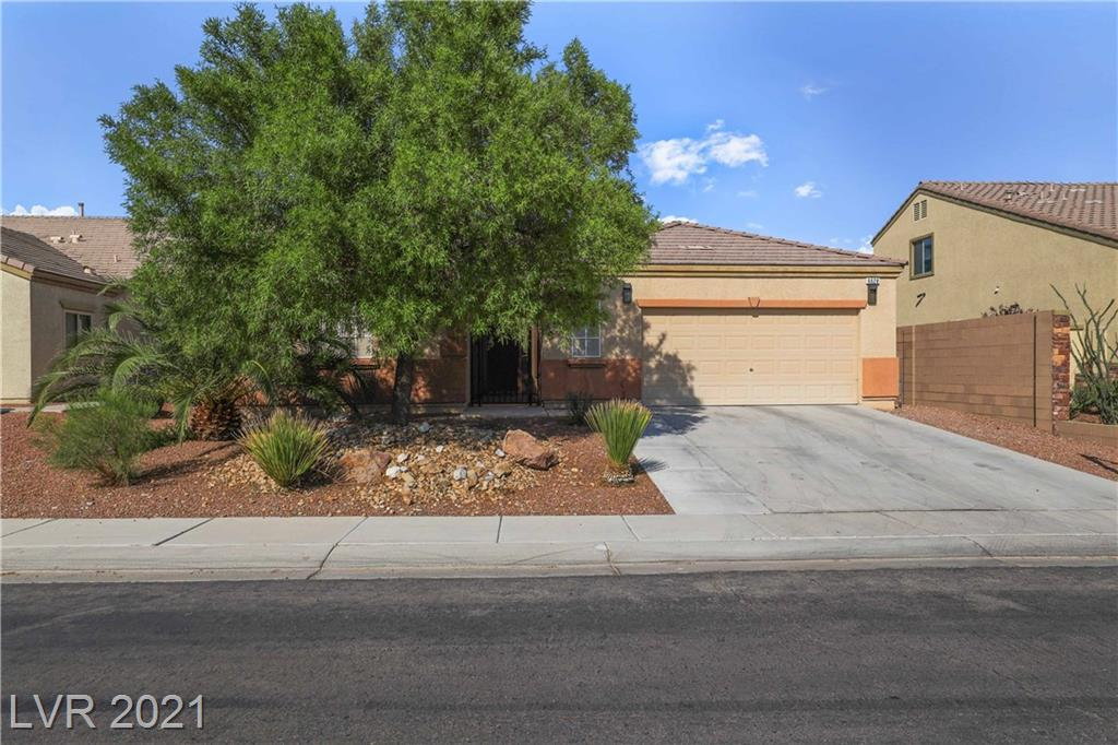 Gorgeous single-story w/3BDRS & sparkling pool in NLV! Lovely courtyard invites into home w/modern layout featuring family room, dining area & kitchen flowing into each other. Amazing home upgraded w/two-tone paint, plantation shutters, ceiling fans, neutral tile flooring t/o w/carpet in primary bed & 1 secondary bed. Generously sized family room is naturally lit w/several windows & elevated w/cozy gas fireplace w/long mantel. Spectacular kitchen enhanced w/granite counters plus backsplashes, breakfast bar/island combo, ss appliances, ss sink, recessed lighting, walk-in pantry, large kitchen nook & separate wet bar. Spacious primary bedroom offers walk-in closet w/mirrored door & sliding glass door & large picture window w/wonderful views of the pool. Ensuite is equipped w/dual sink vanity w/sit-down vanity, soaking tub, water closet & walk-in shower. Your private oasis awaits in the backyard featuring a covered patio, lagoon-style pool, gazebo & mature landscape. This one won't last!