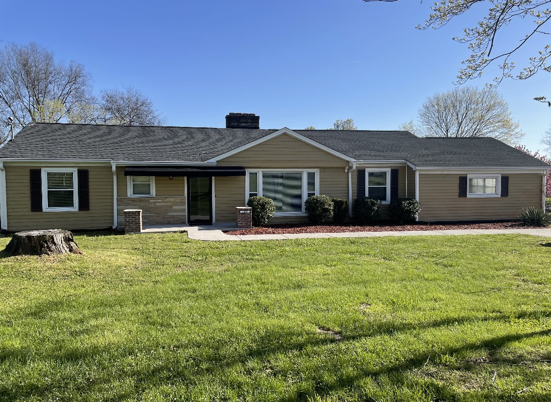"""1930 Sq Ft~All One Level~Newer HVAC~ Roof in 2015~Hardwood Floors~Large Yard~New Detached Carport~Great Space~CLOSE TO SHOPPING~HOSPITAL~SCHOOLS~BYPASS~Updated Bathrooms~30X12 Outbuilding with power(Seller uses as an office). Recently added extended concrete for parking. Home is ready for new owners~ Seller will add a stove. Selling """" AS- IS"""" Showings to begin 4/3/2021 Any offers submitted on weekends to be reviewed on Monday afternoon"""