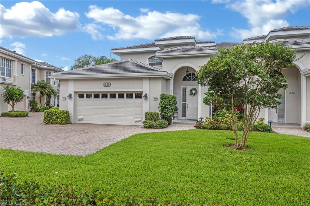 In the heart of North Naples is the beautiful and lush community of Pelican Marsh, and in the heart of Pelican Marsh is Seville. This coach home neighborhood of 21 buildings has the best location and most serene water views in all of Pelican Marsh. Seville has all NEW ROOFING with flat tiles for superior wind resistance. This second floor home has high ceilings, three full bedrooms each with a full bath, a large media room or den, plus a full separate dining room. The east facing lanai offers a long lake view shaded by a magnificent tree for a quiet time and privacy. As one of Naples' premier golf and tennis communities, Pelican Marsh also provides bocce ball, pickleball, a large fitness facility, and a well-managed activity staff keeps the pace with group activities. Within a 5 to 8 minute drive you will also find shopping and dining at The Mercato (with Whole Foods) and Waterside Shops. And as a topper, the beaches of the Gulf of Mexico are a short drive or bike ride away.