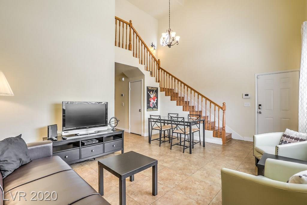 "Highly upgraded and move-in ready luxury living condo is ready for a new owner. This open concept beauty features massive vaulted ceilings, two paint, gorgeous 20"" ceramic tile and laminate wood flooring throughout. Designer kitchen includes granite countertops, custom cabinets with plenty of storage, stainless steel stove/oven, dishwasher, two basin sink and full sized microwave, all overlooking the grand entrance and main living areas. Enormous master bedroom with enough room for two king sized beds, features custom paint, walk-in closet, ceiling fan and functional ensuite bath. Attached garage with laundry & access to unit. Private porch for those warm spring days. Generous secondary bedroom, community pool across from popular park all in a gated neighborhood. Convenient access to shopping, public transportation and more. Welcome home!"