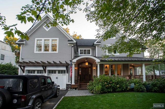 Welcome to this one of a kind architect's dream home which was custom built in 2015 with wrap around mahogany front porch! The main entrance features a 19' double heighted foyer, a formal dining room, large family room with a wood burning fireplace, and spacious office. While the office and family rooms have 11 foot ceilings, the dining room has 12 foot ceilings.  The kitchen features Quartz countertops, Stainless Steel Thermador Appliances and access to the mudroom and private deck with custom built Napoleon grill station.  The second floor features Master Bedroom, (2) Junior suites , & spare bedroom, all baths have custom Porcelanosa tile and radiant heated floors.  The Master Bed has 15' vaulted ceilings; the junior suites have 9 & 10' ceilings.  Basement is fully finished with 9' ceilings, and full bath.  House is perfect for growing family close to schools, train, downtown and parks. House equipped with 22kw full house generator; security system and completely wired for sound
