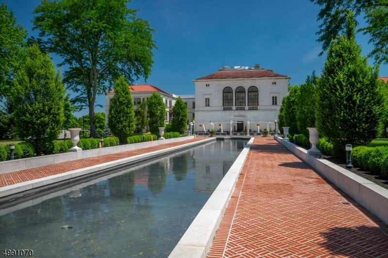 Desirable city living at the highly sought after Vail Mansion in the Heart of Morristown. This fabulous residence truly has it all. Sophisticated open floor plan features gourmet EIK w large island, breakfast bar and pantry, LR, DR, den and/or guest room w French doors, Master Ensuite w spa-like bath and custom WIC, 2nd bedroom and full bath, designated laundry room w full size washer/dryer and utility closet, ample custom closets, 4 sets of French doors w Juliette balconies, HW floors, exquisite millwork, concierge services, 2 assigned parking spaces in private garage, fitness center, media screening room, club room w lounge, private storage area. Adjacent to Jockey Hollow Bar & Kitchen and MAYO PAC. Enjoy fantastic neighborhood restaurants, shopping, and much more! NYC trains just blocks away!!!