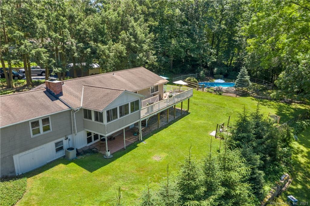 Single level living….bring your bathing suit! Spacious ranch with refreshing pool. Ideally situated on private 1/2 acre in sought-after Fairfield Woods neighborhood. Open concept floor plan, hardwood floors & vaulted ceilings. Kitchen with stainless appliances flows to living room with fireplace and dining room with french doors to large wrap-around deck. Deck overlooks expansive property.  Perfect for entertaining or just relaxing. Inviting family room with vaulted ceilings.  1st floor primary bedroom with glass doors to deck. 2 additional bedrooms on main level.  Spacious walk-out lower level with full bath, playroom & bedroom or office offers many options. Just 1.5 miles to scenic Lake Mohegan with beach, swimming, sprinkler park and expansive hiking trails.  Minutes to vibrant town center, metro north train, shopping, beaches, golf, marina & parks.  Waterfront community 50 miles from NYC offering coastal charm, historic preservation, wonderful restaurants, shops, theatre & 2 Universities. Don't miss this very special find!