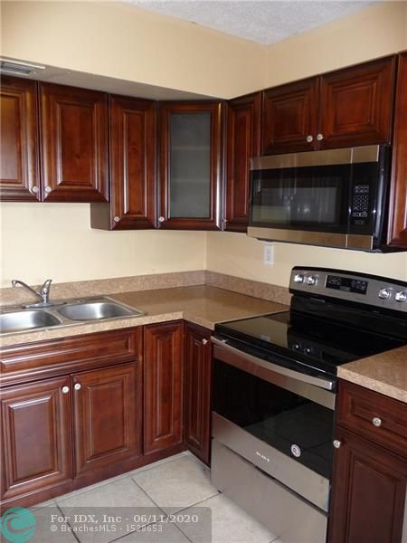 INVESTORS TAKE NOTE!  Condo is currently leased through 11/30/2020.  This updated condo boasts new wooden kitchen cabinetry in a rich mocca color and new stainless steel appliances installed in 2018.  The Living/Dining rooms are spacious and lead straight out to the screened-in patio.  Additional features include a 2018 2-ton Goodman HVAC system and a 30 gallon hot water tank.  The 2 bed / 2 bath set up is perfect for homeowners and investors alike. Up to 2 pets under 25lbs each are allowed.  This unit is priced to sell! Schedule your showing today.