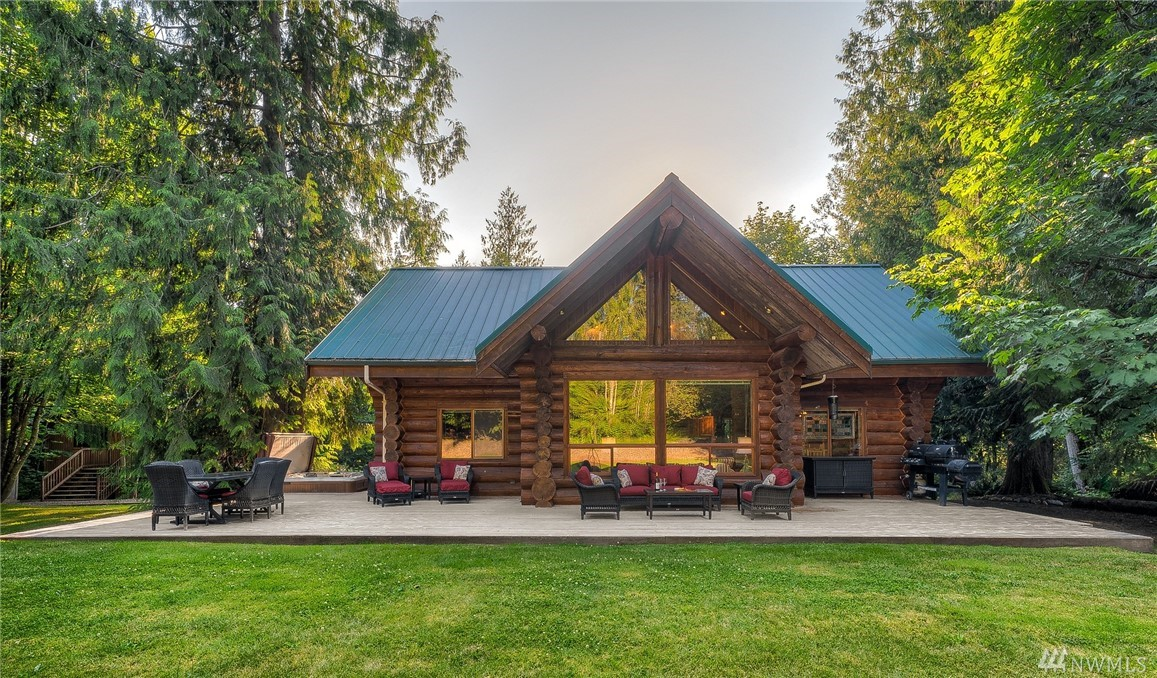 Tucked into a cedar forest, this custom built 2,020 SF log home w/shop, is a rare find in today's market. Retreat to your beautiful 2.5 wooded acre property featuring privacy, outdoor living spaces inc. hot tub & expansive deck. Upper floor master suite, loft & bdrm. Main level chef's kitchen w/ blue pine cabinetry, great room anchored by river rock fireplace, lg bdrm & bath. Partially finished 1,000 SF room over 3 car garage. Mtn Living near the city makes this the perfect place to call home.