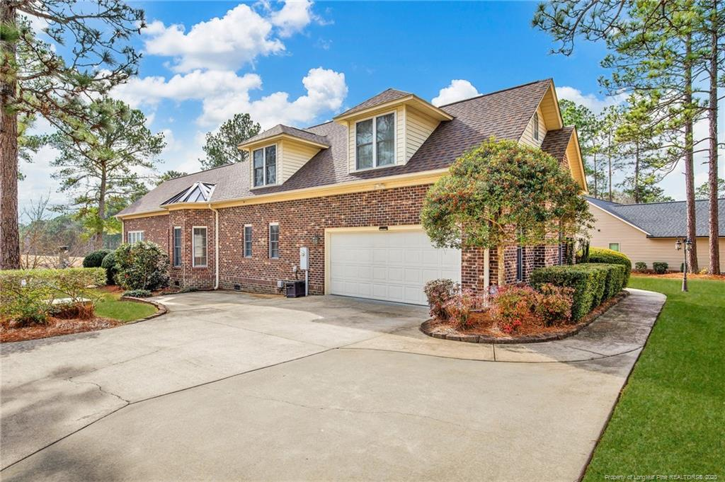 Masterful Design&Luxury Appointed Amenities Embody this Stunning Lakefront Home Located in Carolina Lakes.This Brick Home is Over 4000 Square Feet w/a Side Entry 2-Car Garage and a new roof installed on 2019. Walk In To The 2-Story Foyer. Spotlighted is the Wet Bar w/Custom,Built-In Shelves&Stunning Dual-Sided Fireplace. The Formal Dining Room Exudes Modern Elegance. The Kitchen is Complete w/an Oversized Island & Walk-In Pantry. The Divine Master Suite Presents w/a Trey Ceiling w/Recessed Lighting&An Incredible View of the Lake. Step Inside to Your Master Bath w/Two Separate Vanities That Feature Granite Counters & Fountain Sinks. His/Her Side Walk-In Closet.Second Floor w/a Bonus Room,Full Bath&Extra Room. Step Outside to the Private Sunroom Overlooking Patio&Lake. Extended Patio Features Cover w/Ceiling Fan,Built-in Area for Grill&Custom-Built Fireplace.Beyond Patio is Spacious Backyard Leading up to a Large Deck and Boat Dock & Lift & sprinkles that waters from the lake.