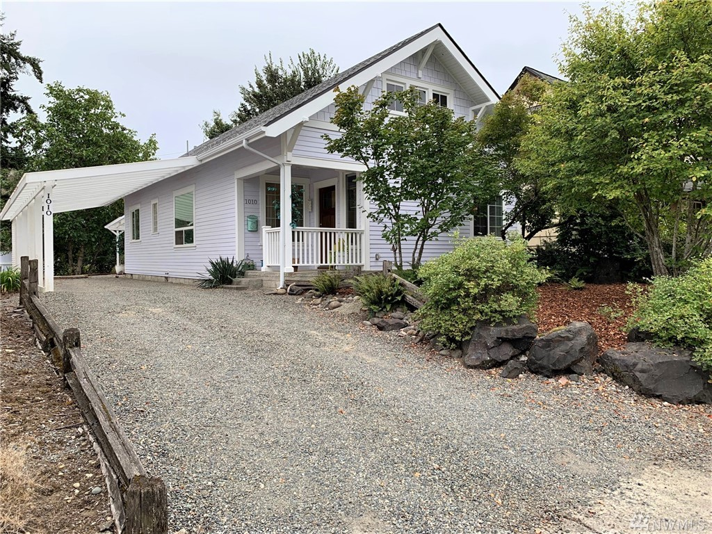 """This home has recently been renovated so it's in """"Like New"""". New Roof, siding, covered car port, covered patio, hard wood floors, new paint inside & out, windows, insulation, plumbing, wiring, etc.  You're not going to find a cuter place, elegance mixed with country chic, make this 2 bed + office home perfect as a starter or down sizer. Close to college, parks, restaurants, post office and historical downtown Centralia. Storage shed & lean to sits in back yard."""