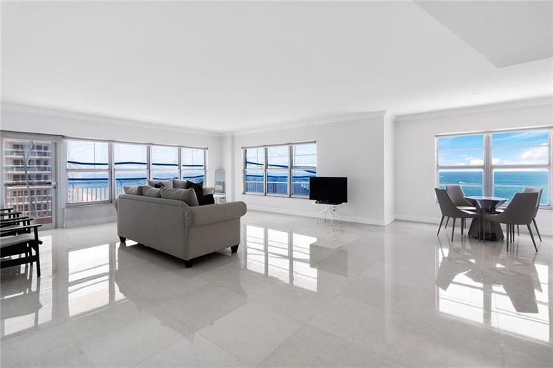 This spectacular NE corner unit sits directly on the sand in the heart of the Galt Ocean Mile.Unit has been fully renovated with top of the line materials. The open plan embraces 3 bedrooms ALL with beautiful ocean views and the master bedroom boasting 2 walk in closets. When walking into this unit you are greeted by direct ocean views on the north and east side of the living/dining room & kitchen. Huge living area connects to an open kitchen layout complete with granite counter tops and black stainless steel appliances.  Matching 32x32 custom marble throughout unit. A few additional perks are a separate laundry area with full size washer/dryer, additional storage on same floor, deeded garage space (35k value). Maint includes WIFI, Adv cable w/HBO,water, sewer & pest control.