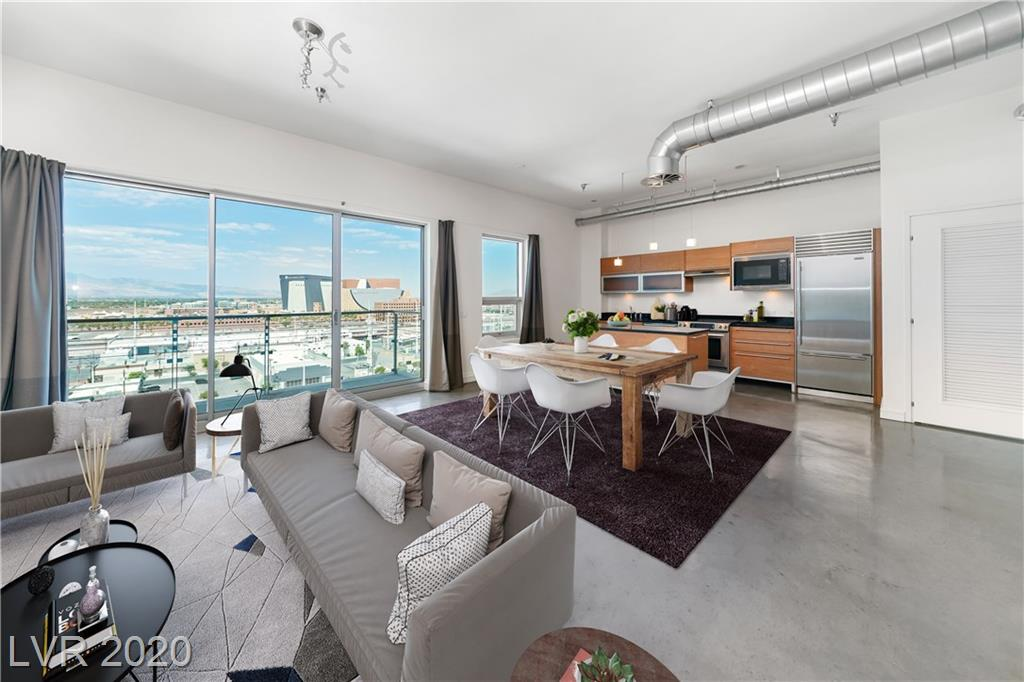 Live in unparalleled luxury from your very own loft style residence in the sky overlooking downtown. The unit features a European cabinetry, granite countertops, gas stove top, custom lighting, an oversized modern bathroom and the added privacy of a partitioned walled bedroom. You'll want for nothing at this full service building with an on site concierge, porter, security, HOA office and state-of-the-art rooftop strip view pool,jacuzzi, gym, running track, event space and more. A must see!