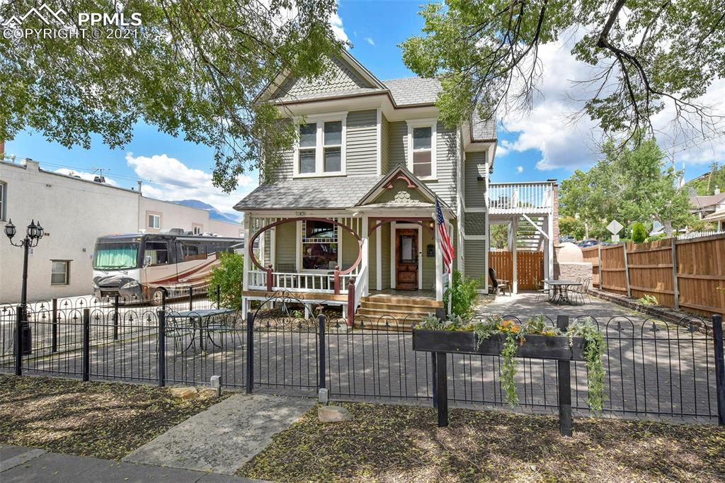Beautiful historic home in the heart of Old Colorado City! Zoned C-5 either residential or a perfect live-in business opportunity! Hardwood throughout, many commercial appliances, updated electrical and plumbing, air conditioning and a hot tub on the patio! Two kitchens, the main level kitchen has been updated to accommodate commercial and the upper level kitchenette with granite counters and stainless appliances. Fencing surrounding the home for privacy and two different parking areas in the front and back of the home! Upstairs apartment with outdoor access and laundry! Great home near food and shops!
