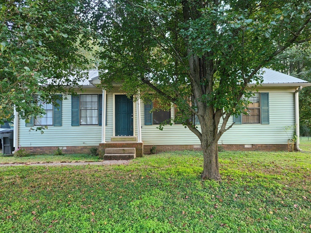 Great starter home or investment property! Featuring oak cabinets in kitchen, sunroom, separate laundry room. 2018 Metal roof and tankless water heater. Very coveted school system J E Woodard!!