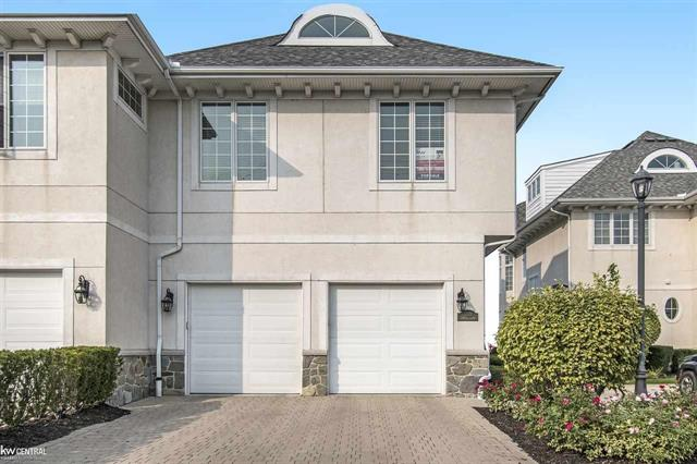 """Have your boat ready to go at this beautiful, prestigious gated community of Venetian Pointe Estates. Vacation in your own backyard! Enjoy all the activities the water has to offer. This unique 3 story condo has breathtaking views from every window of Lake St. Clair and Clinton River. The first floor of this unique condo offers kitchen with all high end appliances (Wolf stove, Sub Zero refrigerator and Miele dishwasher) and granite countertops. The living room offers a fireplace with French doors leading to brick paver patio, turret sitting area which gives you a excellent view of Lake St. Clair and Clinton River and crown moldings throughout. Amazing second floor master bedroom with fireplace, with 11x10 walk in closet. French doors leading to balcony to enjoy your morning coffee. Very accomodating second floor laundry room which includes washer and dryer. Third floor bonus room measures 49 x 16 for all your entertainment needs... can be your """"man cave"""" or game room area."""