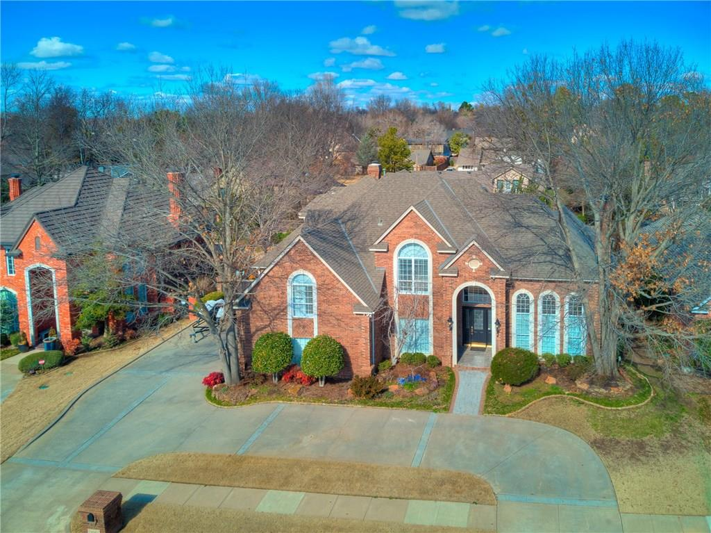 "This incredible home is a rare find, located in SW Norman in ""The Trails"" just across from The Trails Golf Course.  It offers an element of surprise with the open spaces and sophistication that one finds immediately upon entering the front door to a grand staircase and floor to ceiling windows with beautiful views of the backyard. Phenomenal design and finish work throughout! Abundant natural lighting makes it feel light and airy boasting large windows throughout! The resort-inspired backyard offers plenty of entertaining space as well as a sparkling pool featuring a rock waterfall and lush landscaping all around! A versatile plan offers 5 bedrooms and a bonus room, 2 spacious living areas plus a huge rec/media room! A chef's kitchen is open to the casual living area. Hardwood floors up and downstairs, plantation shutters, solid core doors, crown molding, 2 fireplaces are just a few more extra special features. A large laundry room w/built in desk is a great home office too!"