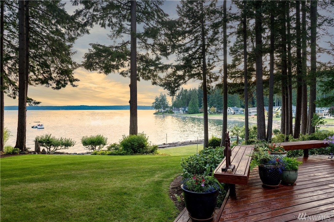 This cutting-edge Northwest Contemporary home features bold use of open spaces, views from every room, and one of the largest waterfront lots in Gig Harbor: 138 feet of no-bank waterfront, sandy beach & buoy for your boat, walls of windows to take in the views, cedar decks & circular drive, incredibly private 1.73 acres, and a separate shop/studio w garage & greenhouse. Never before offered for sale, this architectural award-winning home on Driftwood Cove is a once in a lifetime opportunity.