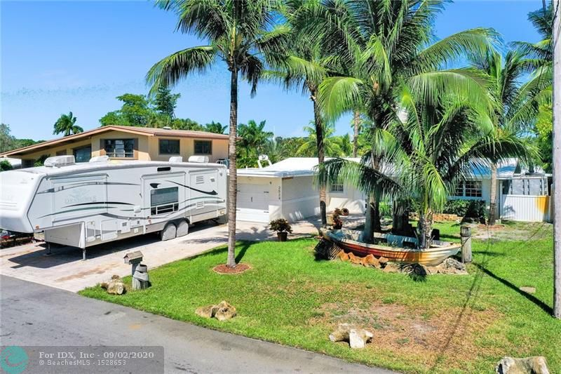 MUST SEE WATERFRONT HOME... Make this beautiful 3/2 home your forever STAY-CATION! COVID making travel impossible? Why bother when you can live like you're always on vacation? Large master bedroom with walk-in closet, remodeled bathroom, and French doors that open to your paradise! Second bedroom also offers access to the backyard via French doors. After a long day, relax in the second bathroom's jacuzzi spa tub. REMEMBER THIS HOME IS YOUR PARADISE! A backyard to die for: waterfront, patio, bar, and pool spa. Bring a boat or TWO! Yes, two boats can fit perfectly for a max of 60 feet with a 10,000 lb lift! There's a 1 car garage with plenty of room to expand to a two car garage. Driveway allows space for an RV, boat, truck, car, and more! Words won't do this home justice, COME SEE IT!