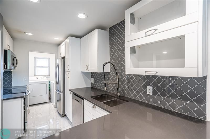 Convenient Oakland Park location! Located one mile from the Wilton Drive Entertainment District, this two bedroom two bath condo is close to numerous shops, restaurants, and grocery stores. Located in a secluded community, this condo features updated polished porcelain tile throughout along with numerous updates.  The updated kitchen features Samsung appliances and quartz countertops. The water heater and A/C are less than 7 years old. The Middle River Homes Condos feature a large pool and access to the Middle River.  The community is pet friendly with restrictions.