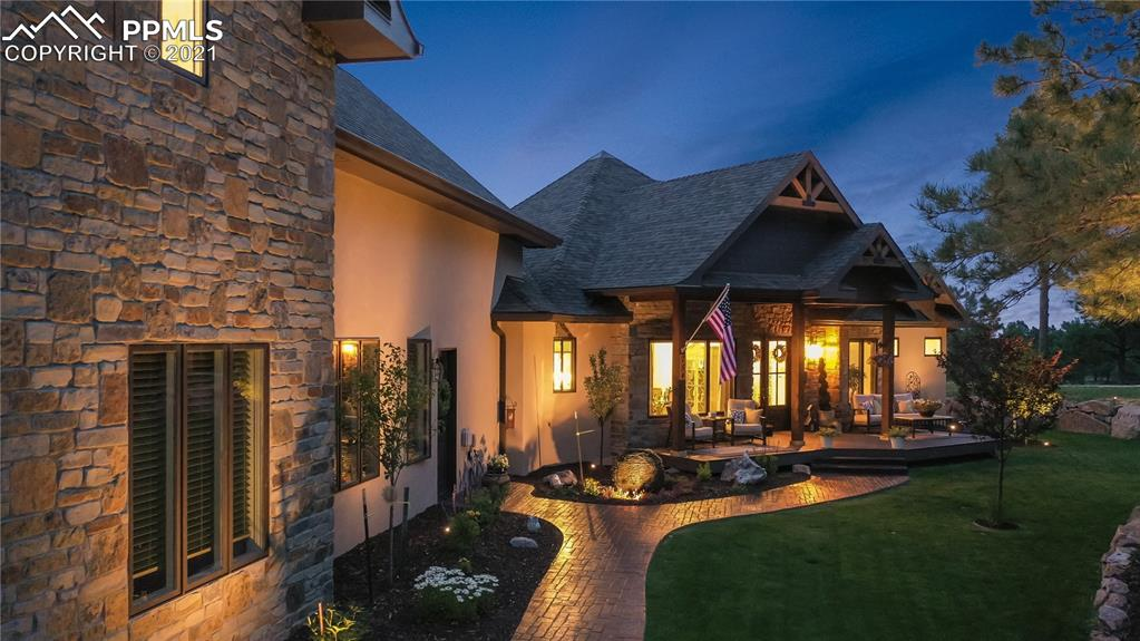 This fully custom home was built for the owner of Kimber Construction, so no detail was overlooked * 2020 Parade of Homes People's Choice Award recipient and you'll see why! * Quality, superb craftsmanship, style and design defines this home * At first glance, take notice of the great outdoors with 2.55 acres of land, open space, trees, entertainment spaces, and so much more * Enter through the double front doors to a tantalizing display of Old World charm to include hickory floors, vaulted ceilings, tons of natural light, and a warm hug inviting you home * Open kitchen is an absolute delight, featuring a large island with Quartzite countertops, counter seating, induction cooktop, 6-foot fridge/freezer, all Dacor appliances, walk-in pantry, bar nook with beverage fridge, alder cabinetry with stunning hardware, and dining nook * Dreams came true in this master retreat! This spacious room includes a fireplace with antique custom mantel, walkout to back patio, massive closet with lots of natural light and full custom cabinetry, an elegantly relaxing bathroom with heated flooring, dual entry shower, tub, and lots of space * The coziest Living Room features a magnificent stone fireplace with hearth, a sliding glass wall that opens to patio, and late 1800 barn wood beams * Dining area; Office; Family Room with tons of windows, custom built-ins and fireplace; Laundry room, Mud Room with custom built-ins, Powder Room and a Guest suite complete the main level * Upstairs is an oasis of its own, sure to excite everyone and includes: 2 bedrooms, living room, 2 bathrooms, tall ceilings, views, and storage * The outdoor entertaining areas allow you to enjoy the amazing beauty Colorado has to offer with multiple seating areas and an outdoor kitchen * Unique features of this home, include: All Natural stone; Quartzite counters throughout * Don't miss this exclusive opportunity to own this amazing home!