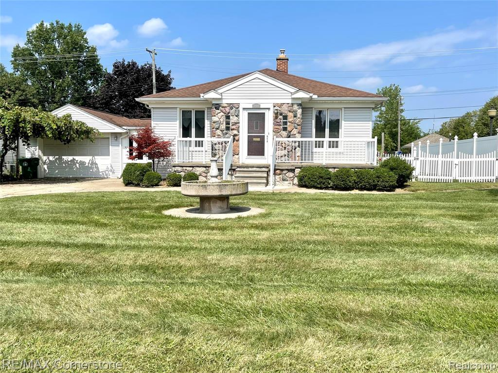 This beautiful home is centrally located in Garden City between Middlebelt and Merriman just south of Ford Rd. This location offers every amenity right around the corner. The HUGE back yard is a must see.  Inside you will have 1159 Sq Ft, 3 bedrooms and 2 full baths, a new furnace, hardwood floors, front porch with sitting area, large basement with tall ceilings, attached garage with additional storage room attached, grape vine covered carport for shaded parking and plenty of driveway for all to park. And did you see how big this yard is! This home is ripe for the picking. Don't hesitate, schedule a showing.