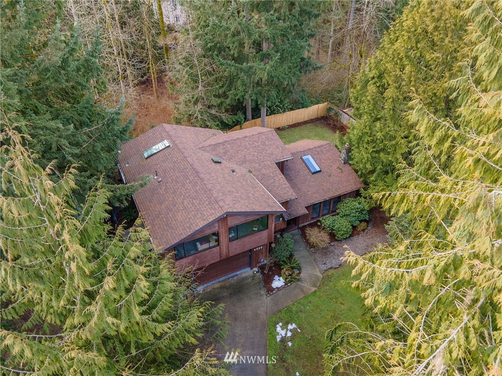 The unique architecture of this spacious home has mid-century vibes w/soaring ceilings & 2 living spaces. Secluded on .83 acres, the whole home stays cozy w/wood & pellet stoves on private HOA-maintained road. Master w/en-suite bath & incredibly PRIVATE UPPER DECK. 4 large BR's total! Covered deck off kitchen and deck off dining room for outdoor living at its best. Space for hobbies, toys & work. NEW ROOF in 2019, NEW FURNACE & HEAT PUMP w/dehumidifier in 2020, NEW CARPET & LVP flooring in 2021! Both sun & shade gardening spaces for flowers & veggies.  Woodworkers shop w/power. RV & Boat parking. Coveted West Lake Tapps HOA: Access to 4 parks including Jenks Park & Beach, BOAT LAUNCH, playground, DOG PARK, volleyball, tennis courts & more.