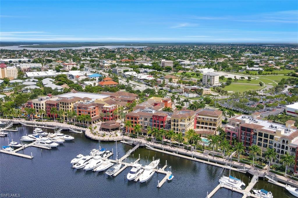Be in the center of it all! This three bedroom two and a half bath end unit, with large wrap around open lanai is located in the center of Marco Island at The Esplanade. The Esplanade is a coastal Italian-style village with the finest dinning, upscale shopping, and entertainment that Marco Island has to offer.  This luxurious 2400 sq. ft. unit has spectacular views of Smokehouse Bay and community pool.  With just steps from your front door, enjoy the atmosphere of this coastal Italian-style village all at the center of Marco Island.