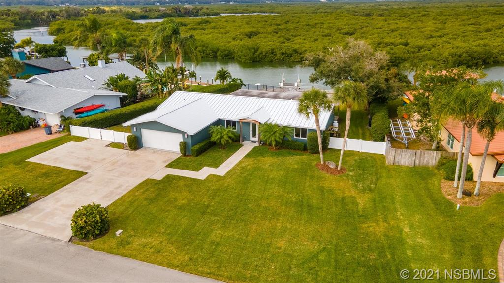 Renovated 3 bedroom, 2 bath, deepwater canalfront home with easy access to Intracoastal & Inlet.  Large dock with 10,000 lb lift plus 16' floating dock.   Impact double pane windows & sliders.  Light & bright open floorplan with amazing views of the water & wildlife.  Watch the canal come alive in the morning & enjoy beautiful sunsets in the evening.  Bamboo flooring with stone in baths.  Renovated kitchen features stainless appliances, Silastone counters, wine refrigerator & large breakfast bar.  Spacious livingroom with gas fireplace.  Master suite overlooks the water as does the living room, dining room & kitchen.  Covered porch with Ipé decking.  Renovation in 2009 included new metal roof, electric & plumbing.  HVAC 2012.  Smart irrigation with reclaimed water & raised garden bed.  Be ready for fishing & camping with commercial ice machine & RV hook-up with 30 amp service & plenty of parking for your toys!    Outdoor shower. Hunter Douglas silhouette blinds.  Spray foam insulation.  Fully fenced back yard for kids & pets (side fencing belongs to neighbors).  This is a great location, close to both Flagler Ave & downtown!