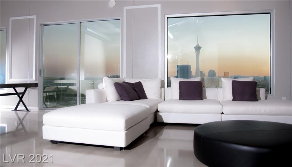 Highrise living at its finest. Upgraded to the max. Custom crown molding & paint, European style cabinetry, stainless steel appliances, custom closets & shelving throughout, upgraded marble look main bathroom, stack stone columns, modern lighting, remote auto window shades and more. Look no further for spectacular strip views. Buyer & agent to verify all. Must see & compare to others