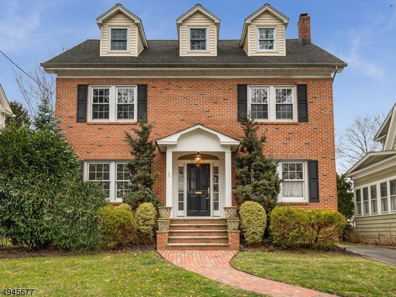 Welcome to your very own elegant brick Colonial! This move-in ready, 5bdr/3fb home is pristine & beautifully updated w/ ample space for everyone! Close to train to NYC it is a commuter's dream! Enter thru the grand front door & find a beautiful entryway w/ elegant dining room to your left and spacious LR w/ original stone fireplace & adjacent sunroom to your right. The EIK w/ sitting area and fireplace is the perfect place for entertaining! Upstairs, four generous bdrms with spa-like full bath. The third floor boasts a master suite unlike no other! W/ WIC, custom bathroom, and plentiful space, you will find yourself relaxing easy! The large finished basement graced w/ fireplace is perfect for movie nights! Enjoy dinner al-fresco on the back deck/patio overlooking your lush yard! No Flood ins. required.
