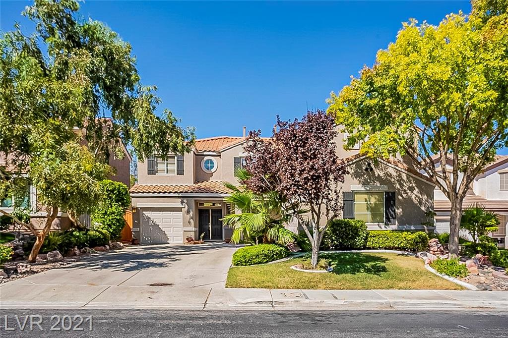 GREAT LOCATION IN GREEN VALLEY W/ VIEWS OF THE STRIP. This beautiful Henderson home is move in ready, located on a cul-de-sac. HOA only $33 a month HOME FEATURES: 6 Bdr, Dual Staircase, Fully Remolded Kitchen w/ Frigidaire Gallery stainless Appliances w/ travertine backsplash. Remodeled custom travertine bathrooms. Backyard has gorgeous built in spa and patio w/ lawn.