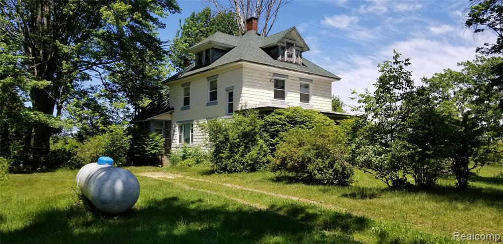 This 3-story home on FIVE acres has space for everyone, accommodating any need!  Over 2900sqft of finished living space in this early 1900's home full of character – just needs your love and attention.  Listed as 6 bedrooms (one on 1st floor) but use your imagination to accommodate an office/den/playroom - the 3rd floor is currently a play room but could be an amazing bedroom.  Dual staircase to 2nd floor.  Boiler is missing so only cash or conventional loans only with lender who will allow this type of sale. Home sold As-Is, any personal property in home will be buyers responsibility to remove. Parcel ID 021011000092500 also included in the sale of this home. Sale subject to Probate Court Approval. BATVAI.