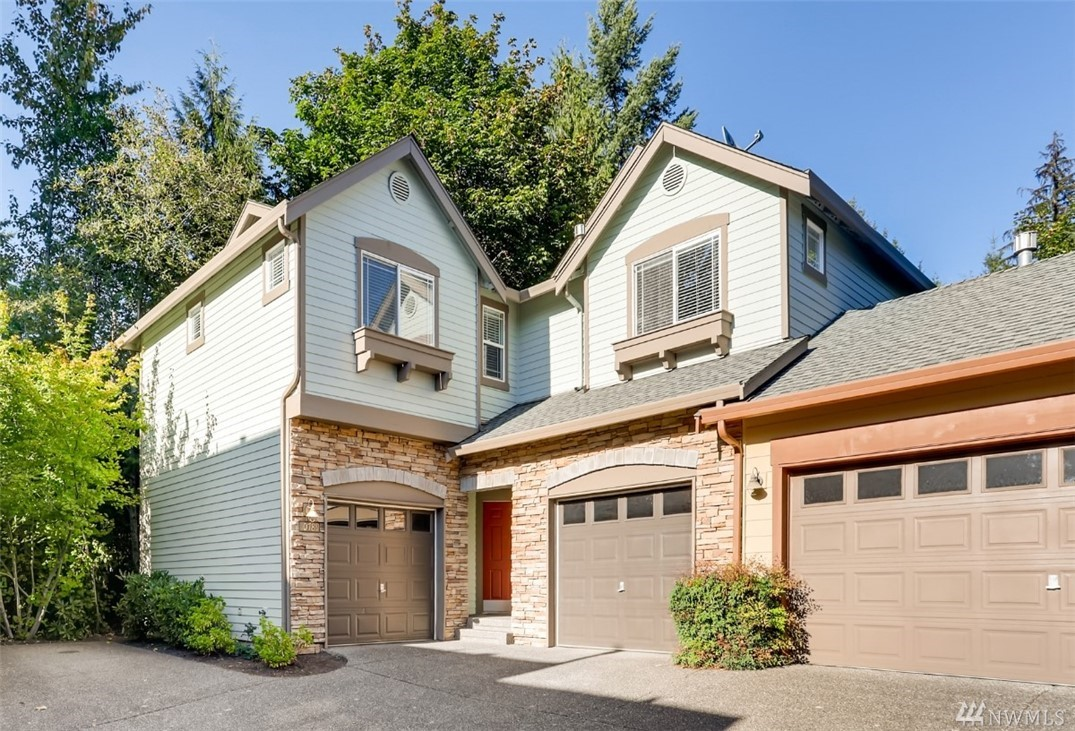 Hard to find 4 BDR + Bonus room home under 800K! This meticulously maintained home is central to everything in the Redmond Ridge community. Just a short ride to Microsoft & located min to shops, schools & parks. Stunning hardwoods, brand new carpet, w/ new paint inside & out. Kitchen updated w/ quartzite counters, artisan tile backsplash & SS appliances. New WH just installed. 2 separate garages make this the perfect house to set up a shop. Welcome home!