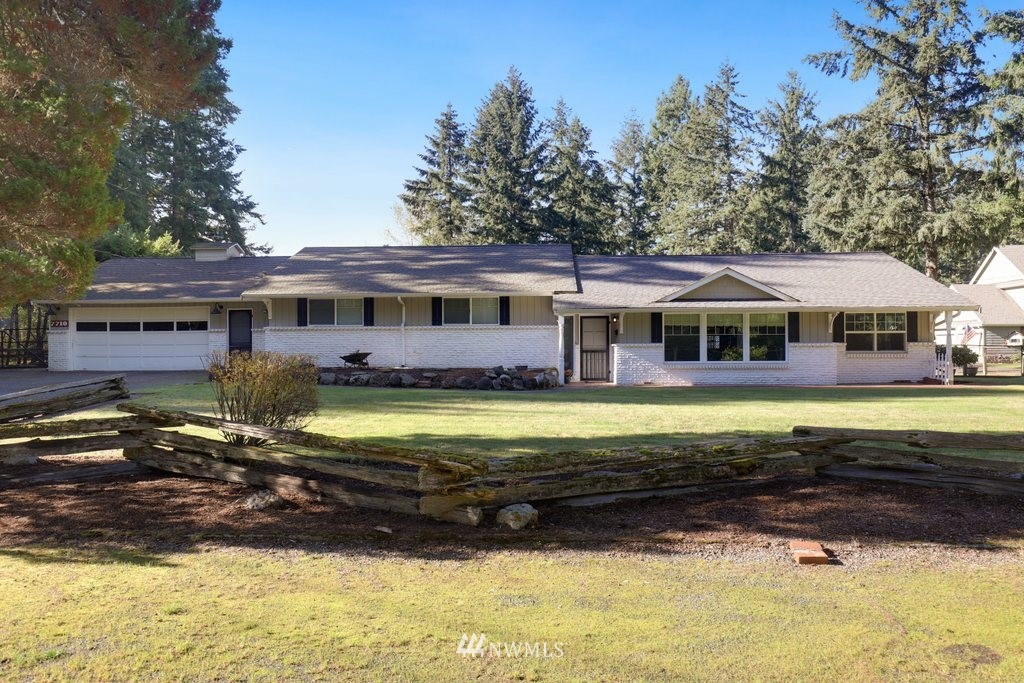 Gorgeous setting for this ranch-style home on 1-acre! Open concept 4 bed/2.5 bath home boasts unique features & plenty of extras including vaulted ceilings w/ beams, floor-to-ceiling fireplace, & wide-planked solid wood floors. Expansive master w/ large his/hers closets & ensuite bath. Newer windows, alarm, heat pump, attached garage, covered RV parking, over 1,000 sf of outbuildings, huge covered patio, generator hook-up, tons of storage, & all appliances included! Endless possibilities await!