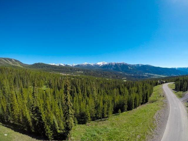 Enjoy spectacular views along with privacy on this 1.18 acre homesite in Spanish Peaks.  With open space to the east side of the lot, build your mountain dream home nestled amidst mature pine trees and grand views of Spanish Peaks and Lone Mountain, along with all the club amenities.  Approval to Spanish Peaks Mountain Club is required.