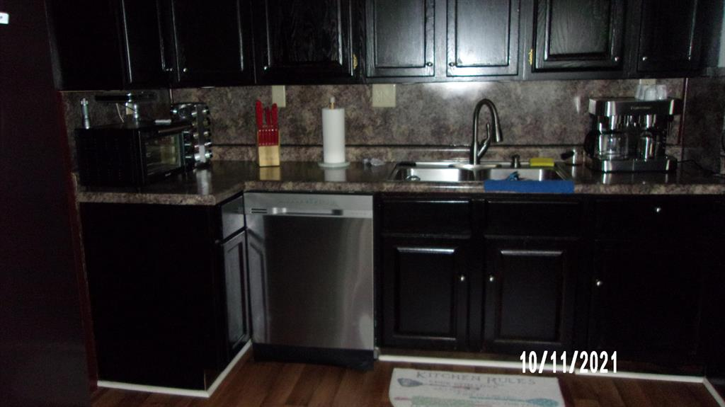Updated home with newer kitchen, windows, roof and flooring. 1 Bedroom is a walk thur.