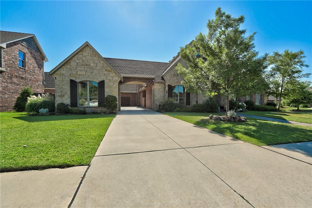 Superior quality & design is the hallmark of this home. After entering the quiet cul-de-sac, you will be greeted w/a stained concrete walkway & 2 painted front doors. Upon entering notice hand scraped hardwood flooring & soaring grand entrance. Formal dining, granite throughout, kitchen w/an island, built in banquette, copper table top imported from Mexico, and stainless steel appliances. This home has fabulous fixtures, a custom built in entertainment center, custom drapes, custom painted ornate barreled arch, with 3 other standout art niches. Large upstairs bonus/media/ room with a half bath, projector/surround sound, storage galore, custom loft bed, and custom built bar area.The backyard is fabulous. Hear the sound of a waterfall from your master bedroom in which you can control how soft or loud you would like to hear it streaming off grotto into a saltwater pool that has matured landscaping surrounding it. **Seller offering $8,000 flooring allowance for bedrooms/study/living room**