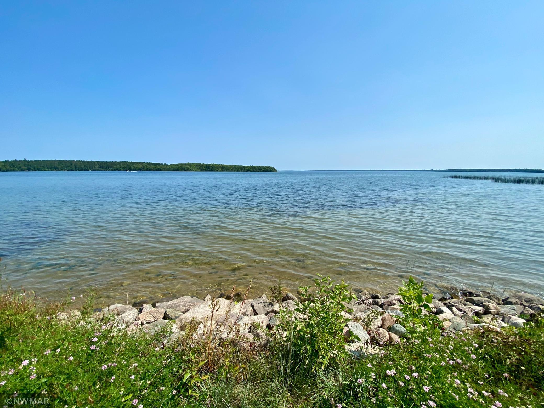Don't miss this rare opportunity to build your dream home on Cass Lake's pristine shores! Enjoy maintenance-free lake living at its finest, which includes ownership in Tom's Harbor Association, unobscured lake views, and wooded privacy on the north side of the property. Lake lot includes exclusive rights to build a two-story structure, a premium covered boat slip, and common amenities including a brand new pool, lodge, fish cleaning house, and more! Set up a time to check out this property before it's gone.