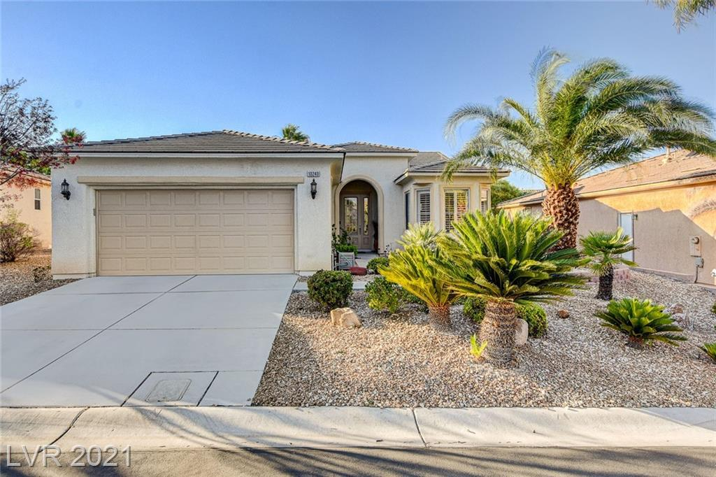 MOVE-IN READY, SINGLE FAMILY RESIDENCE WITH A GLASS FRONT DOOR & SIDELIGHT AND A LARGE REAR YARD, INSIDE A GUARD GATED SUMMERLIN AGE-QUALIFIED COMMUNITY CALLED SIENA, THIS POPULAR '5120' MODEL CONTAINS APPROX 1396/SF, 2 BED, 2 BATH, HOBBY RM/DEN, OPEN GREAT RM, KITCHEN W/ NOOK AREA, BAR COUNTER, RECIPE WINDOWS, STAINLESS STEEL APPLIANCES, LAUNDRY RM W/ WASHER & DRYER, PORCELAIN TILE, WOOD/LAMINATE FLOORING, ALARM, LARGE DECK, COVERED PATIO, 2 CAR GARAGE, PLUS MUCH MORE!