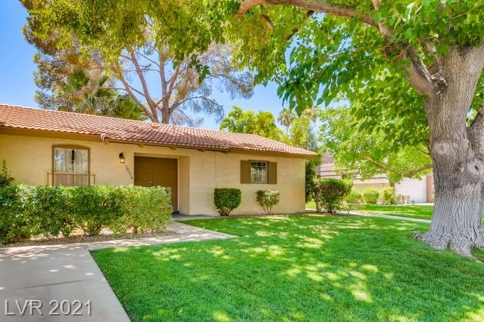 Serene and sought after rare ground level condo with garage on the Las Vegas Country Club.  2 bedrms/2 baths and REAL hardwood floors. Very nice patio off the living rom though sliding doors. All appliances included.  Has been professional cleaned and bedrm carpets shampooed.  Lots of potential for the right buyer. Country Living, City Convenience.  Close to the Fabulous Las Vegas Strip, McCarran Airport, Shopping, Medical Facilities, UNLV, and Convention Center.  This is priced right for a quick sale  One showing will sell this 1 story, ground level condo.
