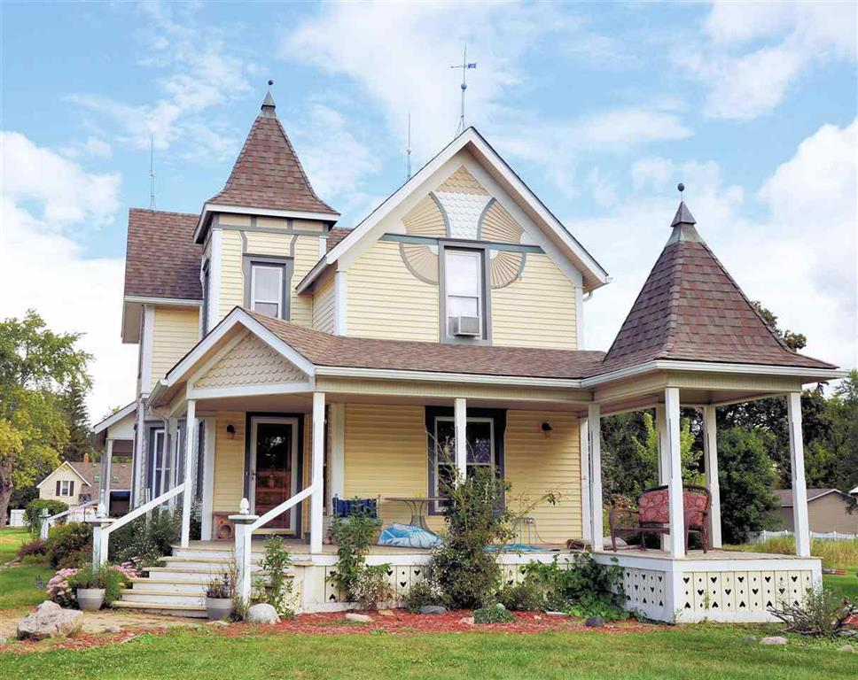 Welcome to this stunning and spacious Victorian home located in the village of Capac on 3 acres!  Main floor features large formal dinning room, living room, lengthy kitchen, office,  2 full bathrooms, Main floor laundry,  breakfast nook and large comfortable sunroom. New hardwood floors In 2018 in Living room, dining room, breakfast nook and office.  2nd floor has 3 bedrooms, full bath and lounge area.    Large Custom closet new in 2021.  Master bedroom currently being used as craft space and is 16x23!  Full finished basement includes kitchenette, wet bar, pool table, gas fireplace, hot tub room, large lounge area, and utility room with workbench and cabinets. New furnace/central air 2018.  New hot water heater 2021.  New dual sump pump on battery backup 2018.    3 car garage with 2nd floor for lots of storage or finish for in law suite.