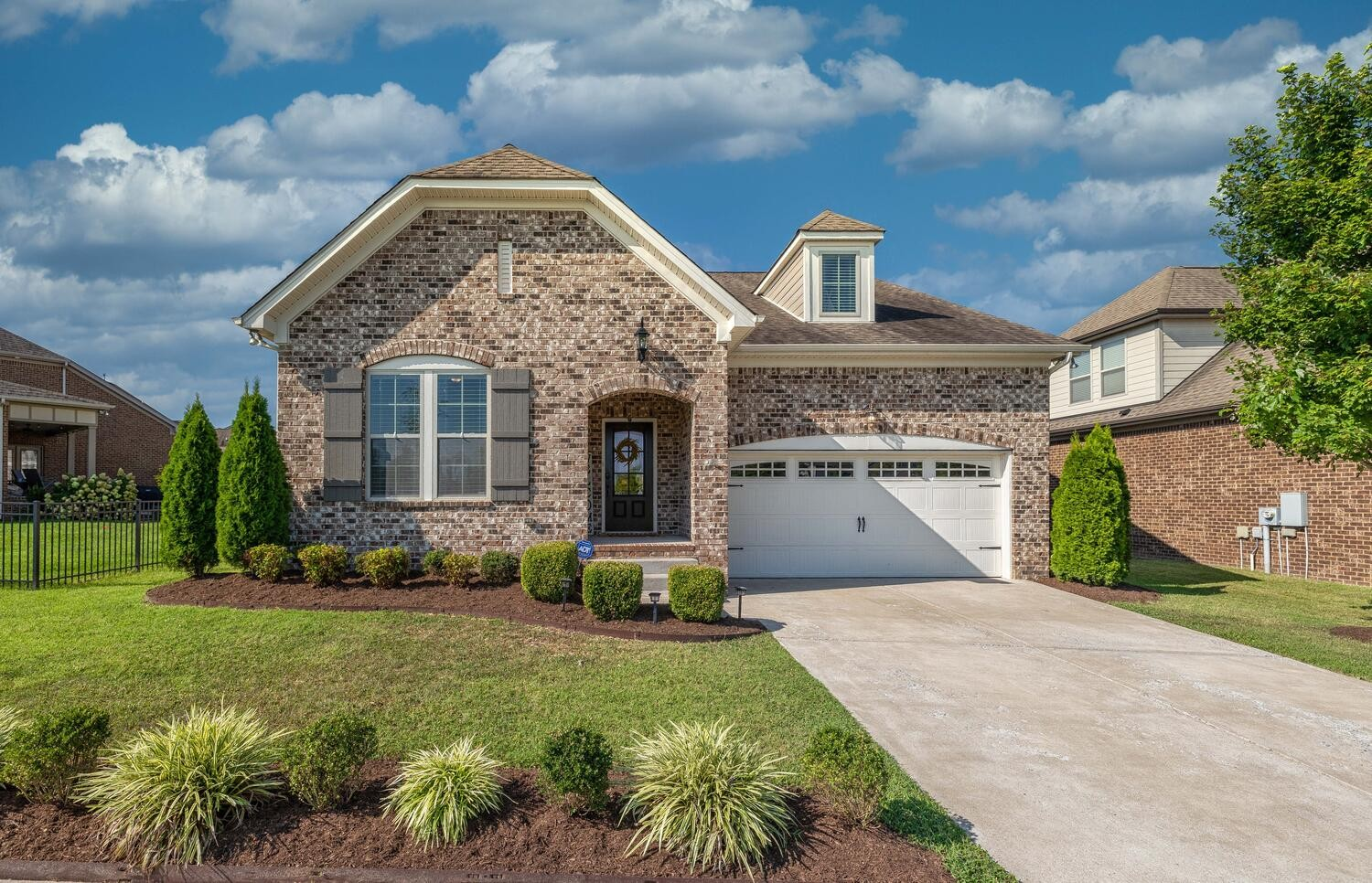This amazing 4 Bed 3 Bath home in the sought after Canterbury Community is a must see! Perfectly located right across the street from the community Pool and Playground! Spacious open floor plan features Wide Plank floors in living area & enlarged Master BR - Upgraded Kitchen Cabinets - Granite - High End Lighting throughout - Vaulted Ceilings - New Carpet - Closets by Design in Master closet. 2 car Garage w Professional Epoxy finished Floors. Fenced in Back Yard. All Kitchen Appliances remain.